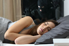 Woman sleeping with an intruder watching Stock Photos