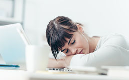 Woman sleeping on the job Stock Images