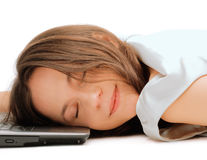 Woman sleeping on the laptop Royalty Free Stock Images