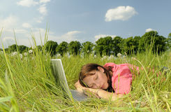 Woman sleeping on a laptop Royalty Free Stock Images