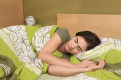 Woman sleeping late Stock Image
