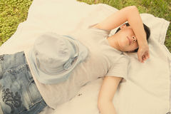 Woman sleeping on lawn Stock Photography
