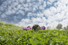 Woman lying on lawn watching sky  Royalty Free Stock Photos