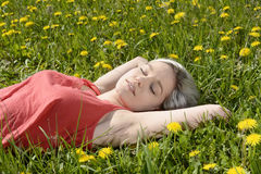 Woman sleeping on meadow Stock Photography