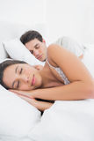 Woman sleeping next to her partner Stock Photo