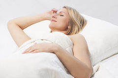Woman sleeping with a nice smile Stock Images