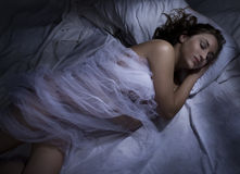 Woman sleeping at night in bed Royalty Free Stock Images