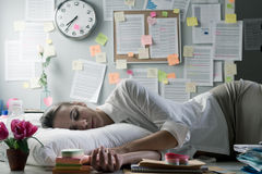 Woman sleeping in office overnight Royalty Free Stock Image