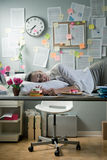 Woman sleeping in office overnight Royalty Free Stock Photo