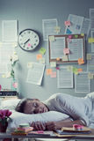 Woman sleeping in office overnight Royalty Free Stock Photos