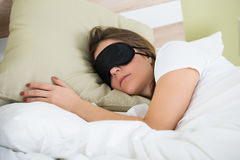 Free Woman Sleeping On Bed With An Eye Mask Royalty Free Stock Images - 77507559