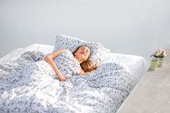 Woman sleeping outdoors on the rooftop Royalty Free Stock Photo
