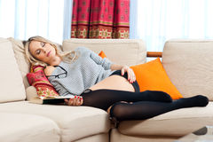 Woman sleeping over book Royalty Free Stock Photos