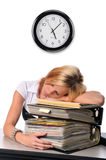 Woman sleeping over a pile of files Royalty Free Stock Photos