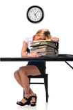 Woman sleeping over a pile of files Royalty Free Stock Images
