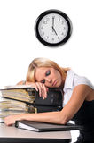 Woman sleeping over a pile of files Royalty Free Stock Image