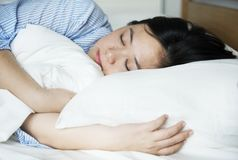 A woman sleeping peacefully on bed Royalty Free Stock Image