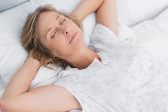Woman sleeping peacefully in bed Stock Image