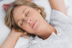 Woman sleeping peacefully in bed close up Stock Image