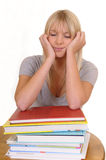 Woman sleeping on a pile of books Royalty Free Stock Photos