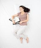 Woman sleeping with racing skates Stock Images