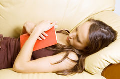 Woman sleeping after reading novel Royalty Free Stock Photo