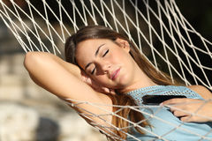 Woman sleeping and resting on a hammock Stock Image