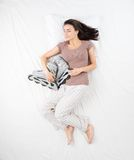Woman sleeping with roller skates Royalty Free Stock Photos