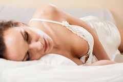 Woman sleeping in sexy nightwear Royalty Free Stock Images