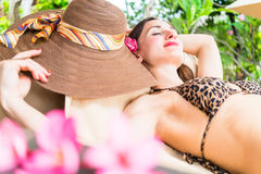 Woman sleeping in shade of palm trees in vacation Stock Photography