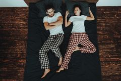 Woman is Sleeping and Snores on Bed with Man stock images