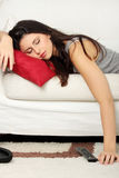 Woman sleeping on sofa Stock Images