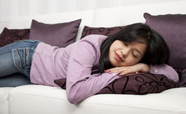 Woman sleeping on a sofa Stock Photos