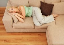 Woman sleeping on sofa Royalty Free Stock Photo