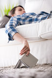 Woman sleeping on sofa with book Royalty Free Stock Photography