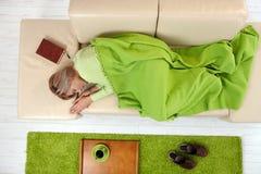 Woman sleeping on sofa Royalty Free Stock Image