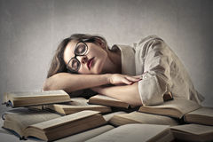 Woman sleeping on some books Stock Image