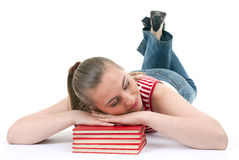 Woman sleeping on the stack of books Stock Image