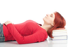 Woman sleeping on the stack of books Royalty Free Stock Photography