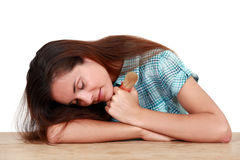 Woman sleeping on a table Stock Images