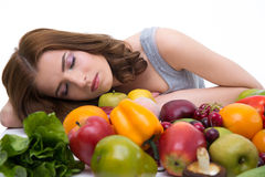 Woman sleeping on the table with many fruits Stock Photos