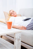 Woman sleeping with tablet on the sofa Stock Images