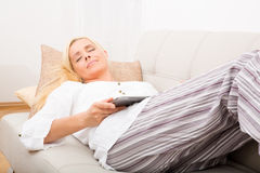 Woman sleeping with tablet on the sofa Stock Photography