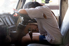 Woman sleeping in truck Stock Images