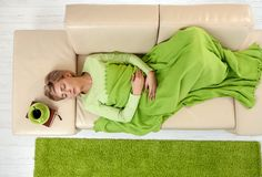 Woman sleeping under blanket Royalty Free Stock Image
