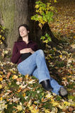 Woman sleeping under a tree Stock Images
