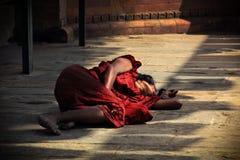 Woman sleeping at walls of hindu temple Royalty Free Stock Photography