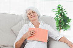 Woman sleeping whereas she was reading Royalty Free Stock Images