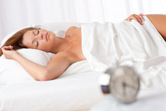 Woman sleeping in white bed Stock Photos