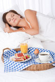 Woman sleeping in white bed Royalty Free Stock Image
